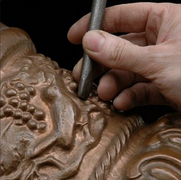 master_coppersmith_carving_copper_vase