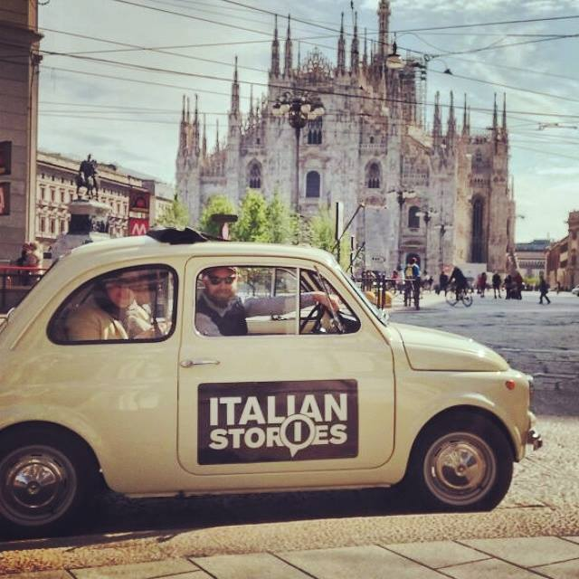 Italian stories team in vintage fiat 500 in front of Duomo of Milan